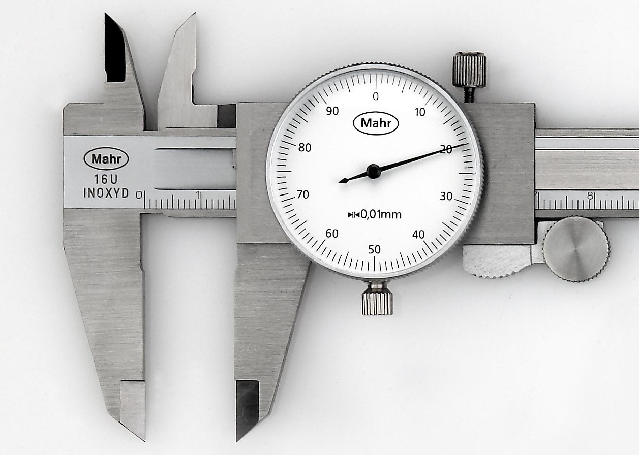 The dial caliper is a dual-purpose instrument and can make either direct or comparative measurements. To make a comparison, first measure the reference dimension and set the dial indicator to zero. Then measure the dimension to be compared. The indicator will show how much the compared dimension varies from the original (plus or minus).(Click on photo to enlarge it)