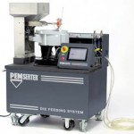 This portable system consists of die tooling, a fastener-feeding system, and a die-sensing system that works in tandem with a stamping press and properly tooled die to feed and install fasteners and eliminate secondary operations typically required for fastener insertions. The system can easily be moved from press to press as needed on the shop floor.