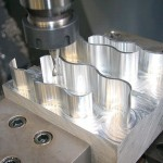 To assess the machining performance at different cutting speeds, the axial machining forces, tool flank face wear, machined surface finish, and hole dimensions were measured. The axial machining forces, while providing a measure of the energy required for the operation, also provide a useful indirect measure of the mechanical and thermal demands on the tooling and the potential tool life to be expected in a given operation.(Click on photo to enlarge it)