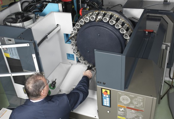 VMCs without a tool magazine endure extended downtime because operators must load tools through the spindle anytime a tool needs to be changed, updated or maintained. With a tool magazine, spindle downtime is minimized and operators are free to set up the following job for higher efficiency.(click on photo to enlarge it)