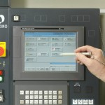 The ideal machine control for a production VMC supports Ethernet, DNC, PCMCIA and RS-232-C and runs a wide variety of part programs, with extensive tool data storage to make informed tooling adjustments on the fly. It should offer the standard six-coordinate work system plus the flexibility to use multiple fixtures and vices on the table.(click on photo to enlarge it)