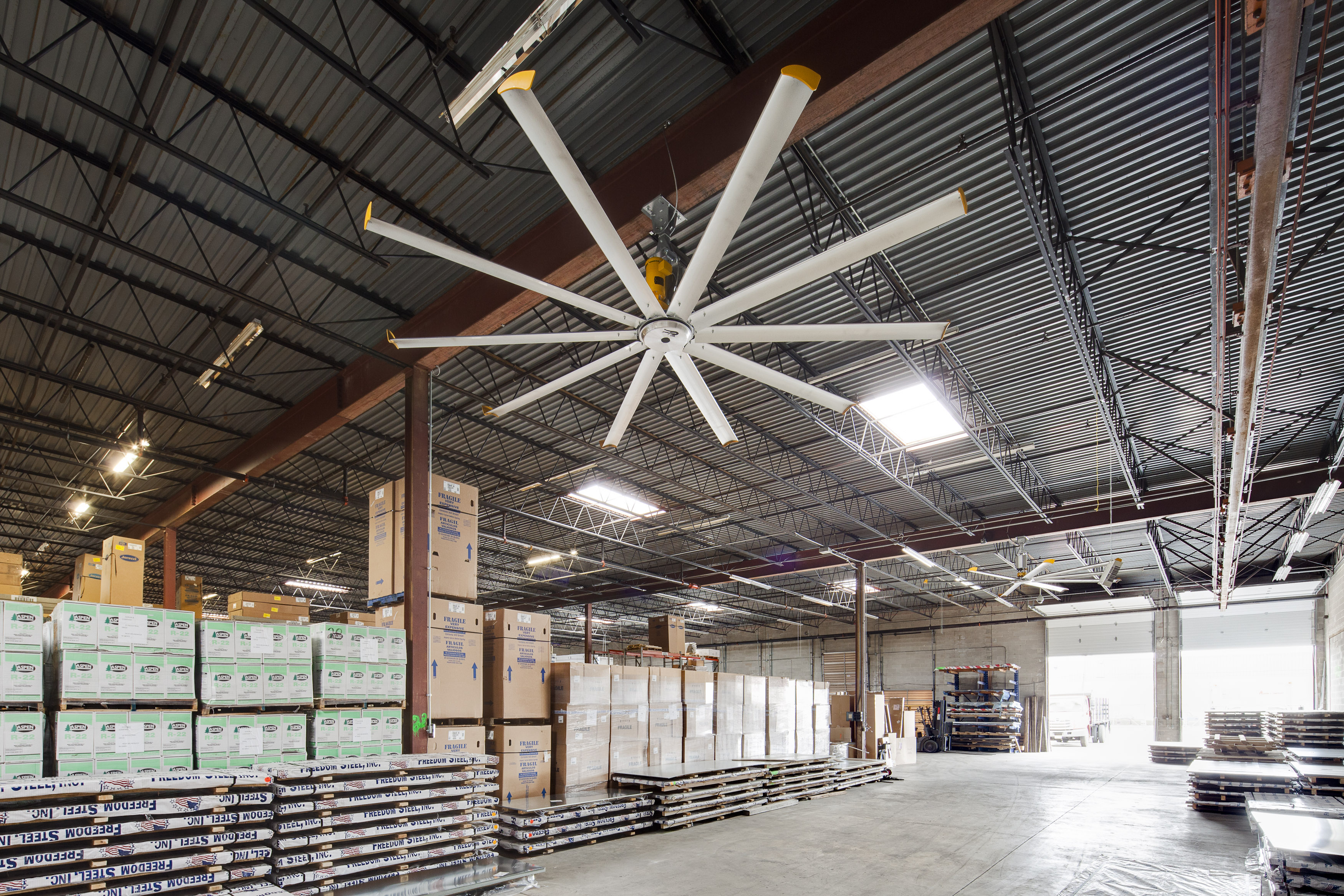 big ass fans in the warehouse of aaron and company in new brunswick nj two 16 ft diameter powerfoil x fans are used in the new jersey steel warehouse