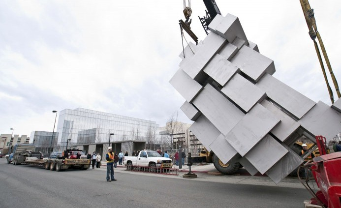 Here is a house-sized sculpture (in the form of a crouching man) created from welding together 57 stainless steel boxes using .394 in thick stainless plate being installed in the urban Alaskan grid of downtown Anchorage in 2010. (Photo courtesy of British sculptor Antony Gormley)