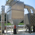 SFC Series downward flow dust collectors capture the dust, fumes and smoke that are periodically emitted when Madison Precision uses fluxing to remove impurities from the molten aluminum and to clean their furnaces. Each of these systems uses drop out box in front of the dust collector to prevent any sparks or hot material from entering the collector.(Click on photo to enlarge it)