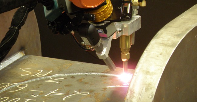 By using precision tool changers robotic systems from Wolf can switch between arc welding, plasma cutting, oxyfuel bevel cutting, pre-heating and other processes.(Click on photo to enlarge it)
