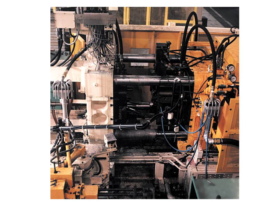Madison Precision uses 21 different aluminum die-casting machines and ten melting furnaces, ranging from 250 tons to 1650 tons, with a melting capacity of approximately 15,200 lb per hour. (Click on photo to enlarge it)