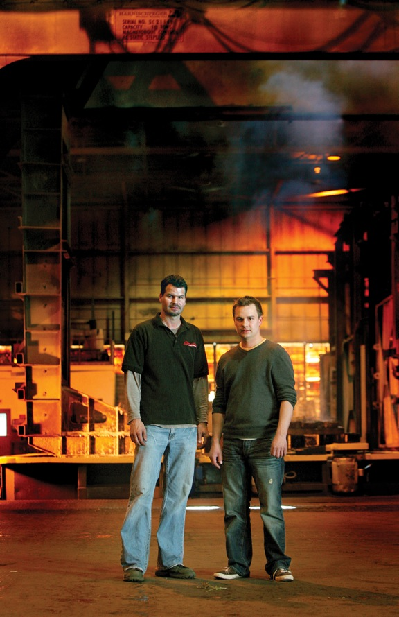 Brothers TJ (left) and Jacob Dolhun operate Complete Heat Treating, a companion manufacturer to Wisconsin Steel Industries, both in the Milwaukee area. Complete uses open fire furnaces and quench tanks to process large steel castings and forgings, metal fabrications and some aluminum parts.(Click on photo to enlarge it)