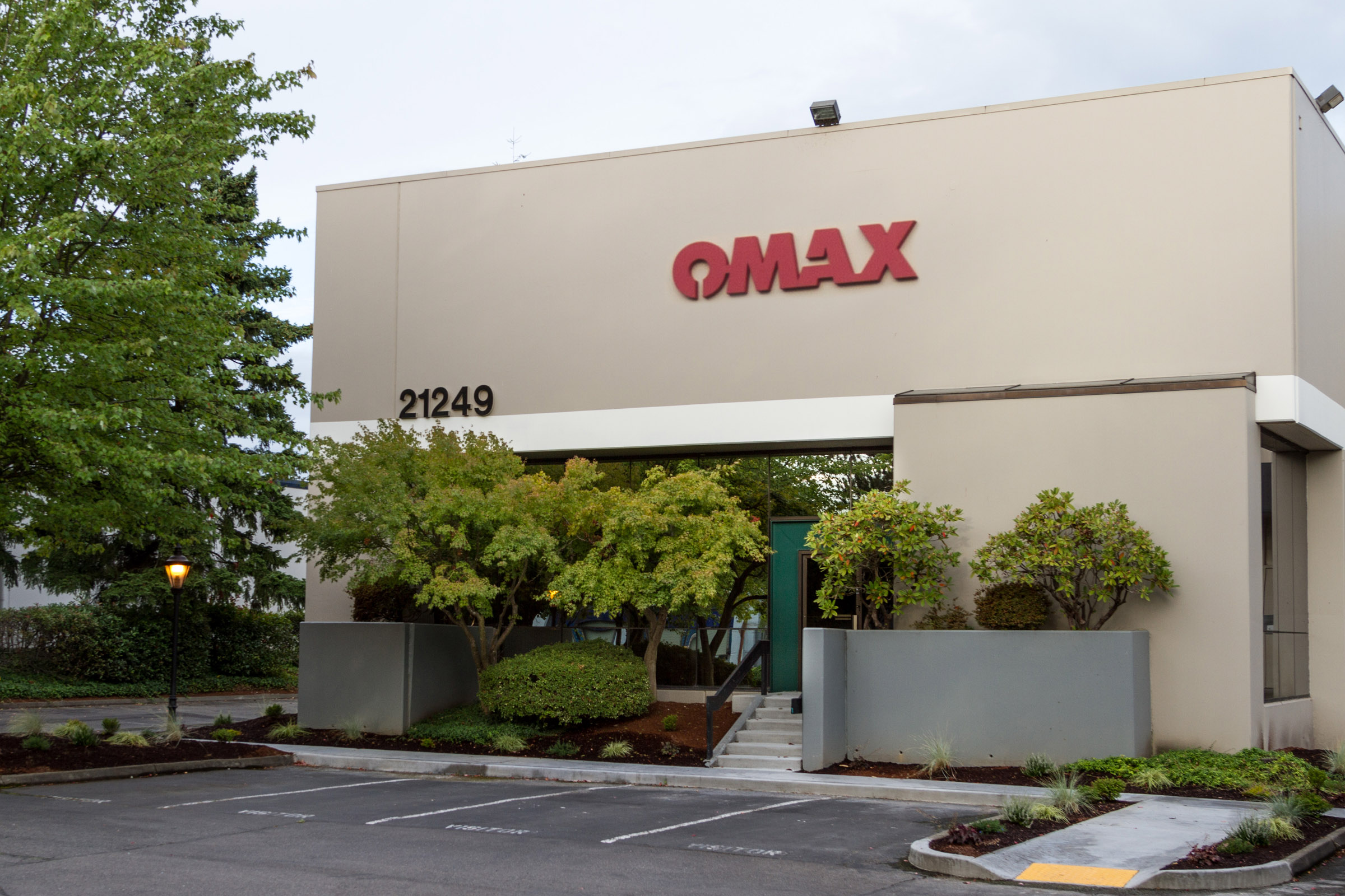 OMAX® Corporation recently added a new 22,000 sq ft building to its corporate headquarters in Kent that extends the company's training, research and development, and engineering efforts.(Click on photo to enlarge it)