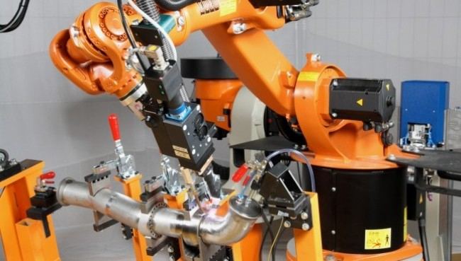 KUKA robots are utilized in a diverse range of industries, including automotive, aerospace, foundry, and metal forming and fabricating as well as multiple applications including material handling, machine loading, welding, bending, joining, and surface finishing.(Click on photo to enlarge it; photo courtesy of KUKA Systems)