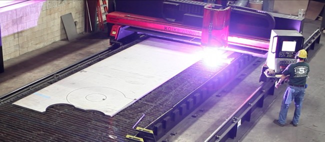 One of the new Koike Aronson plasma cutting systems used by Penn Stainless Products. The two machines operate on one shared rail system to create a cutting envelope of 10 ft wide x 65 ft long.(Click on photo to enlarge it)