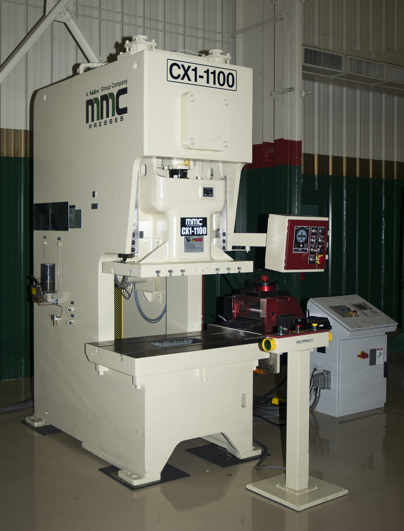 The MMC Press line offers metal stampers a wide range of cost-effective solutions to their mechanical press needs; including single and two-point gap and unitized frame straightsides, and a full complement of tie rod construction straightside machines with crankshaft or eccentric geared drives in two or four-point configurations up to 1,200 tons capacity.(Click on photo to enlarge it)