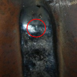 Figure 1. Crater shrinkage cavity in the weld crater.(Click on photo to enlarge it)