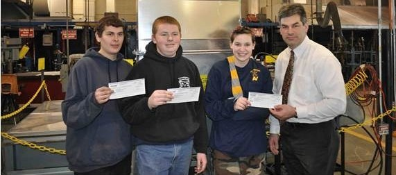 "Students at Assabet Valley Regional Technical High School, Marlborough, MA won both team and individual prizes in the ""Innovation to Shape the World Contest."" Showing off their cash prizes are (l-r) students Jesse Lemanski, Mitchell Miller and Mikayla Bradford, along with principal Mark Hollick.Click on photo to enlarge it)"