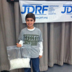 Okuma's Junior Ambassador displays the 1,080 needles he has used over the past six months. Okuma is supporting the Juvenile Diabetes Research Foundation (JDRF) through corporate fundraising initiatives in 2013.(Click on photo to enlarge it)