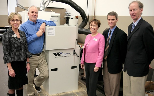 Tooling manufacturer Wilson Tool donates a $14,000 grinder to Anoka Technical College to train students in the Precision Sheet Metal program. Enjoying the moment and the brand new piece of equipment are (from left) Cheryl Kish, Anoka Tech Foundation Director; Nick Graff, Anoka Tech Director of Advanced Technology Center; Jessie Stumpf, Anoka Tech Interim President; Chris Lawless, Wilson Tool President; and Jeff Paulson Wilson Tool Marketing Manager.(Click on photo to enlarge it)