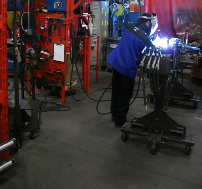 MIG welding of high-horsepower wheeled tractor components in the Jackson, MN facility of AGCO Corporation. Two primary factors that determine output power are material thickness and the diameter of the wire or electrode used for welding.(Click on photo to enlarge it)