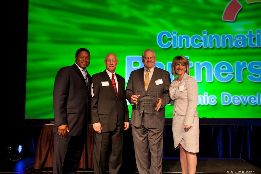Brian Papke (center right), president of Mazak Corporation and Mike Vogt (center left) of Mazak Human Resources, accept the Growth Award from Quinten Harris (left), director of strategic project management for the Cincinnati USA Partnership for Economic Development and Denyse Ferguson (right) also of the Cincinnati USA Partnership for Economic Development.(Click on photo to enlarge it)