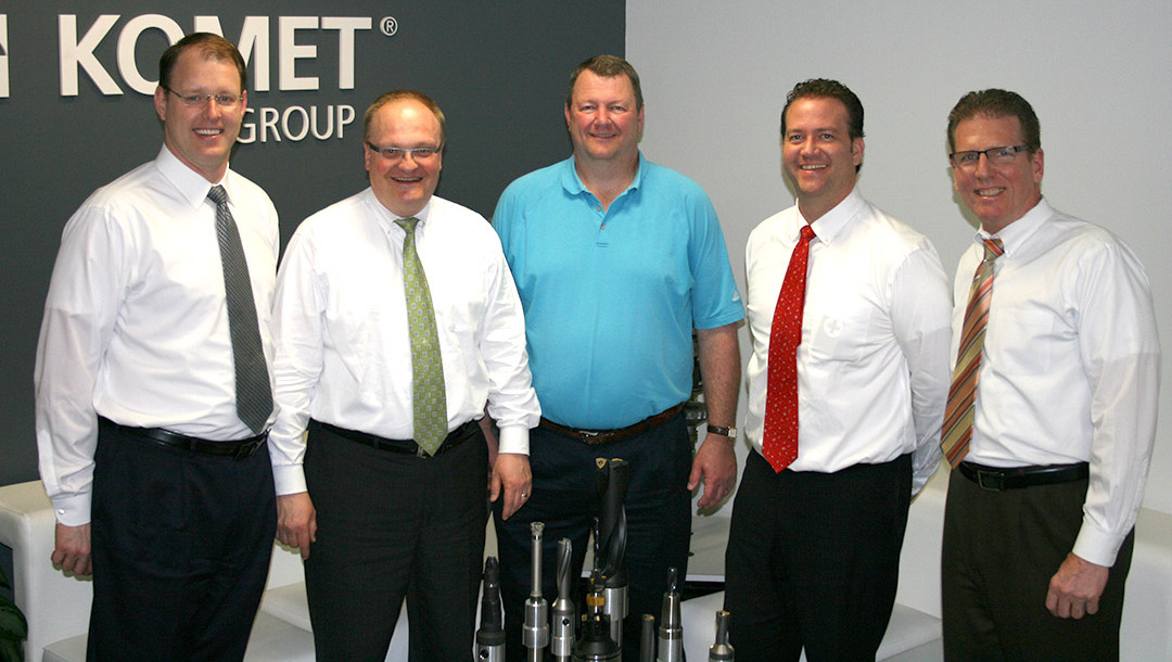 Jim Dinkelacker, the president of Tri-State Tool Grinding (center) and KOMET executives.(Click on photo to enlarge it)