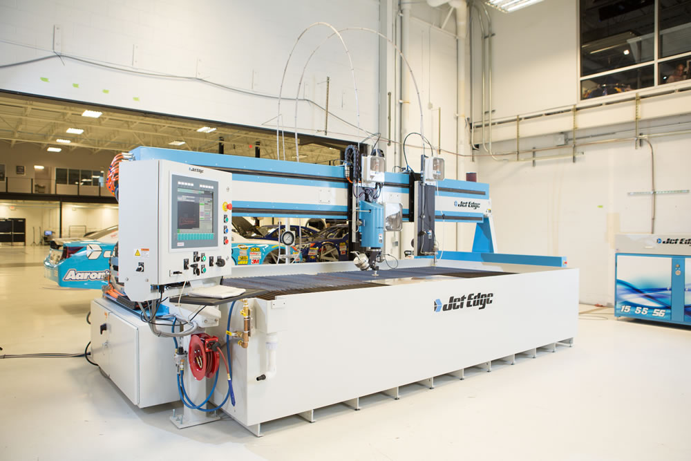 Michael Waltrip Racing's 5-axis Jet Edge EDGE X-5 waterjet system features a 5-axis head and a 3-axis head for increased productivity. (Click on photo to enlarge it)