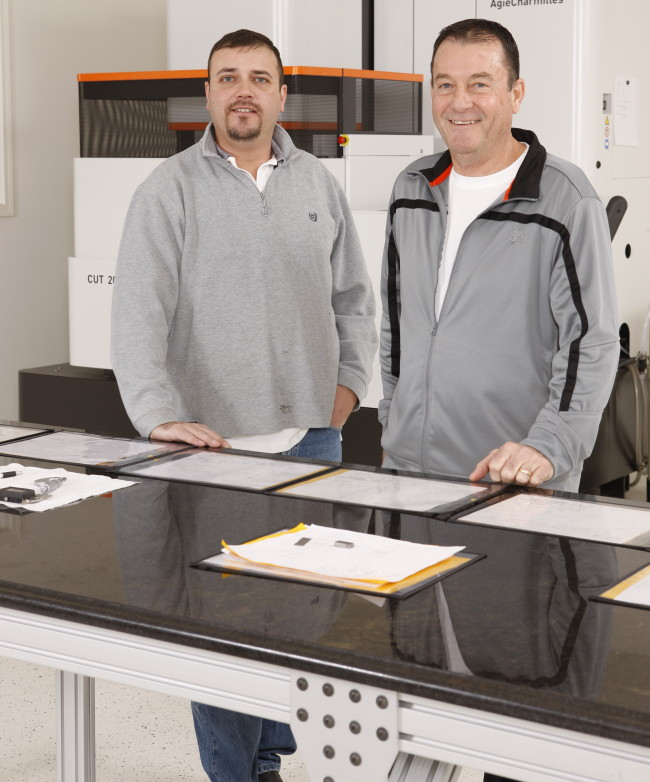 Mike (right) and Eric Blackwell of Scenic Tool and Stamping rely on a CUT 2000 wire EDM from GF AgieCharmilles that uses new third-generation twin-head automatic wire changing to easily achieve surface finishes of .2 Ra. (Click on photo to enlarge it)