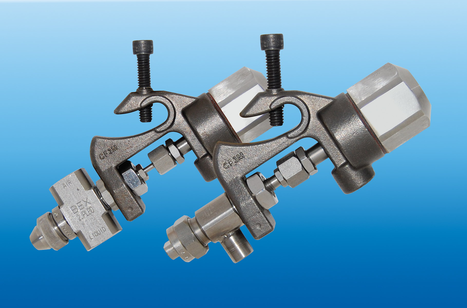BEX air actuated nozzle assemblies are available in T-Tip and Atomizing configurations.(Click on photo to enlarge it)