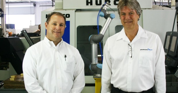 National Sales Manager with Universal Robots, Ed Mullen (right) and Sr. Applications Engineer Phil Hollingsworth from distributor Sparkem Technology with the UR robot at RSS Manufacturing & Phylrich.(Click on photo to enlarge it)