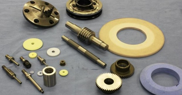 An array of sample parts and tooling options for the machine.