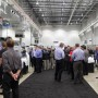 Visitors in the full exhibition area in the DMG MORI Manufacturing Davis facility.