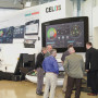 Visitors check out the supersized CELOS model and new design of a DMG MORI NLX machine.