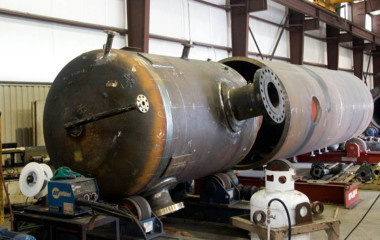 A pressure vessel in the mid-fabrication stages. The pressure vessels Mueller Environmental manufacturers measure anywhere from 4 ft to 8 ft in diameter and are made from ½ in to 3 1/2 in thick 5617 rolled steel plate. The diameter and material thickness depends upon the pressure the vessel must withstand. Sometimes pressures can reach as high as 3,000 psi.