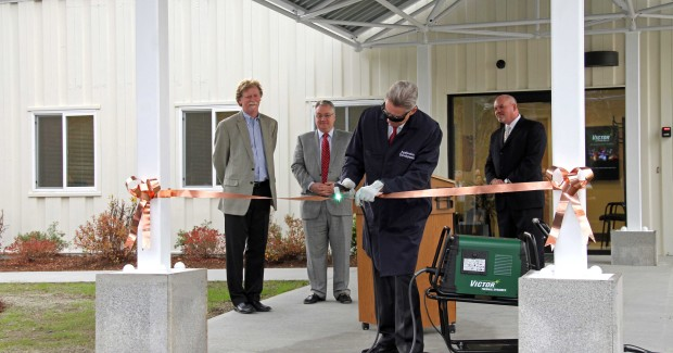 Victor Technologies chief executive officer, Martin Quinn, uses a Victor® Thermal Dynamics® plasma system to cut a copper ribbon, officially opening the company's new Design Center.