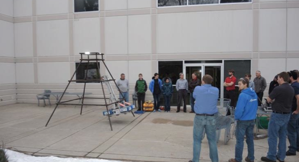 The Fossil Ridge team demonstrates their climbing robot outside of Wolf Robotics.