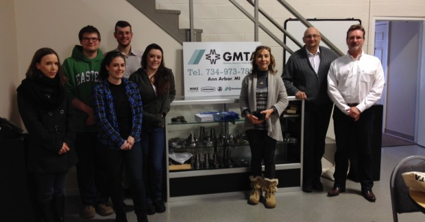 Students from Eastern Michigan University's Language and International Careers (LIC) program visited GMTA for a detailed explanation in German from the company president, Walter Friedrich, right.  Leading the group was Professor Margrit Zinggeler, PhD, third from the right.