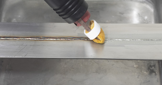 A Surfox unit being used to clean a TIG weld.