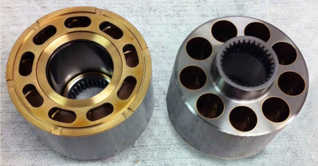 The piston bores of the pump body are not through holes, but have small kidney-shaped slots cut through the bottom. Some designs call for heat treating, use of bronze bore liners, or bronze plating on the bottom of the part, its running face. Lin¬ers may be cast in or produced on Waltz's screw machines, then anchored into retaining grooves with a ballizing process or swaging.