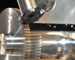 "Allied Specialty Precision Inc. achieves ""done-in-one"" production of sector gears – including the teeth. Gears are completed on a CNC turning center, not a gear shaper, using a form-ground Chip-Surfer slotting tool, not your everyday HSS gear gasher. Results: 10 to 1 reduction in cycle time, quicker delivery, and an 8 to 1 reduction in tool inventory costs for the application."