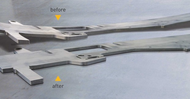 A typical O'Neal part before/after leveling. The FlatMaster uses servo-hydraulics to set the leveling gap, maintain it and adjust forces to compensate for parts with cut-outs, perforations, or odd shapes, such as crescent or triangle. Its leveling rollers can be changed and the unit thoroughly cleaned in minutes to avoid surface blemishes on parts, or contamination when running dissimilar metals.