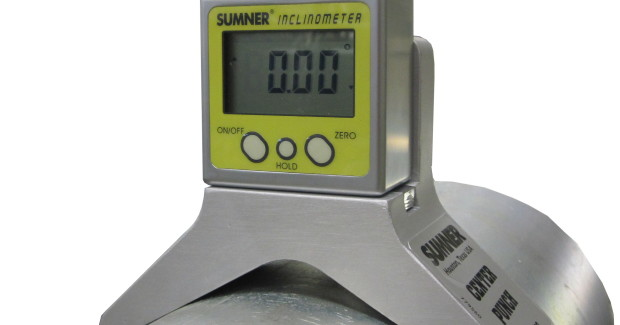 """The Sumner Center Punch is easy to use. Simply set the base on the pipe, turn on the inclinometer gage and adjust as needed until the desired angle is reached. Pull up the spring-loaded hammer and press the push button on the angled base to mark pipe. The inclinometer also includes a """"zero"""" button to reset the angle to zero."""