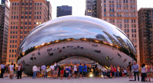 The gigantic stainless steel Cloud Gate sculpture by the artist Anish Kapoor that is located in Chicago's Millennium Park was polished by 24 specialists for several months as the final step. The sculpture weighs over 99 metric tons and has a seamless 10 m x 20 m x 13 m surface that mirrors the Chicago skyline.