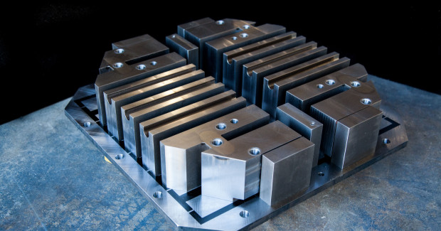 By combining the benefits of a magnetic workholding device with a custom built solution designed around production parts, DocMagnet creates a magnetic turn-key fixture. This system incorporates the benefits of magnetic workholding while reducing set up or change over time between fixtures. (first view)