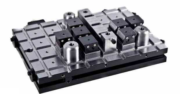 By combining the benefits of a magnetic workholding device with a custom built solution designed around production parts, DocMagnet creates a magnetic turn-key fixture. This system incorporates the benefits of magnetic workholding while reducing set up or change over time between fixtures. (second view)