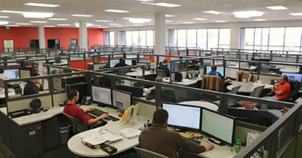 Interior view of open-plan offices. The new facility includes open-plan and private offices for 85 employees and a training center to be used for customer and internal training and educational programs.