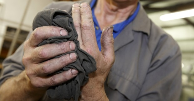 Workers cannot see, smell, or feel heavy metal residue on laundered shop towels, so the risk is not apparent to the many workers who use the towels to wipe parts, spills, and their hands.