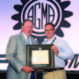 Scott Knoy receives the prestigious Next Generation award from Lou Ertel, chairman of Overton Chicago Gear and also current Chairman of the Board of Directors for AGMA, at the 2014 AGMA annual meeting in Orlando, Florida.