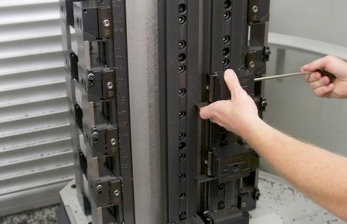 Workpieces are mounted and handled on a Fastems 10-station pallet changer. The block sizes run 56 in number in sizes from 1 in x 2 in x 2 in to 3 in x 9-1/2 in x 14 in. Weights range up to 114 lb. (second view)