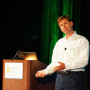 The chief executive officer of Vero Software, Richard Smith, shown  presenting at the conference.