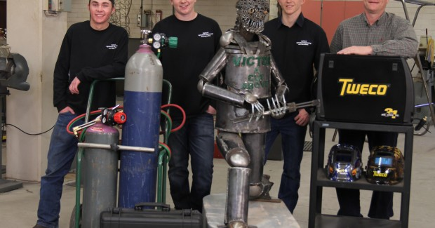 "This ""Victor Man"" sculpture won Highland High School a Victor cutting and Tweco welding package valued at more than $4,000. Shown (l-r) are Garrett Shafer, Ryland Barney, Cody Gifford and instructor Curtis Willems."