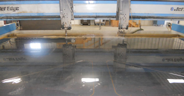 Precision Waterjet Concepts uses a Jet Edge 4 ft x 4 ft High Rail Gantry system equipped with four abrasive jet cutting heads that is powered by a 150 hp waterjet intensifier pump.