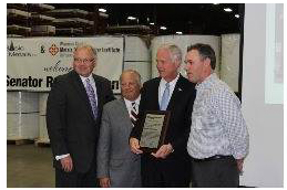 (l-r) Senator Ron Johnson accepts plaque from Robert M. Weidner, III, president and chief executive officer of MSCI; Todd Fogel, owner of Basic Metals; and Greg Head, general manager at McNeilus Steel, Inc., and president of the Wisconsin Chapter.