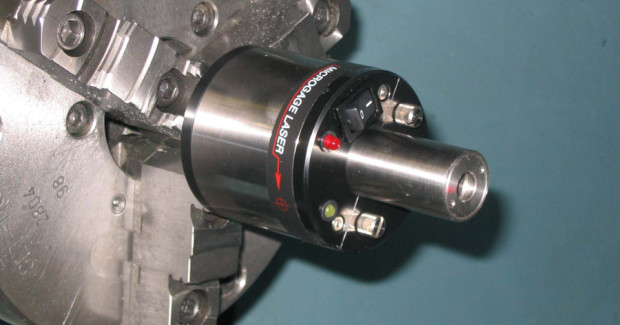 A laser is placed into the machine chuck, spindle or another rotating part to project a narrow beam that extends the centerline of the chuck or spindle down the length of the machine tool. A receiver is secured into an opposing spindle, attached to a moving tool holder, or similar machine element to collect the laser light. As the chuck turns and/or the tool holder or opposing spindle moves, the relative position of the laser beam to the receiver will move if misalignments are present.